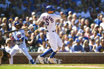 Chicago Cubs' Nicholas Castellanos watches his 3-RBI double during the second inning of a baseball game against the Pittsburgh Pirates Saturday, Sept. 14, 2019, in Chicago. (AP Photo/Paul Beaty)