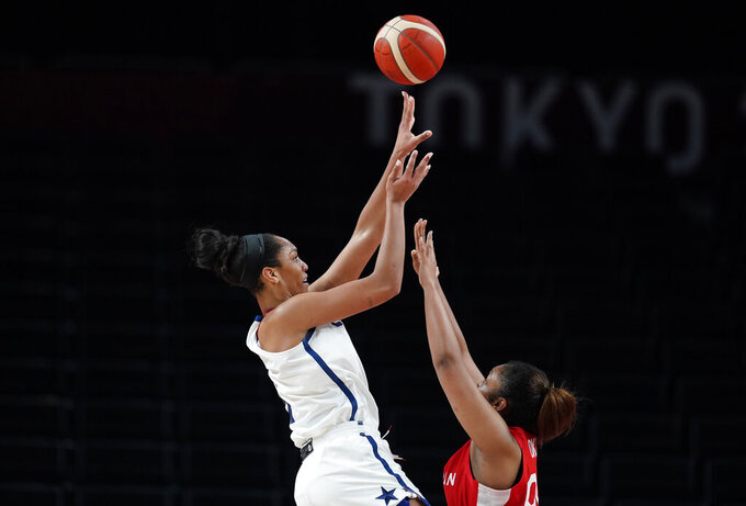 United States' A'Ja Wilson (9), left, shoots over Japan's Monica Okoye (99), right, during women's basketball preliminary round game at the 2020 Summer Olympics, Friday, July 30, 2021, in Saitama, Japan. (AP Photo/Charlie Neibergall)