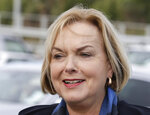 FILE - In this July 30, 2020, file photo, New Zealand opposition National Party leader Judith Collins arrives at a salmon factory in Christchurch, New Zealand. New Zealand has suffered a steep economic downturn due to the virus and is borrowing billions of dollars to try and stem job losses and rebuild. National is promising to increase infrastructure spending. (AP Photo/Mark Baker, File)