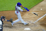 New York Mets' Amed Rosario hits a walkoff home run off New York Yankees relief pitcher Aroldis Chapman in the seventh inning of the second baseball game of a doubleheader, Friday, Aug. 28, 2020, in New York. (AP Photo/John Minchillo)
