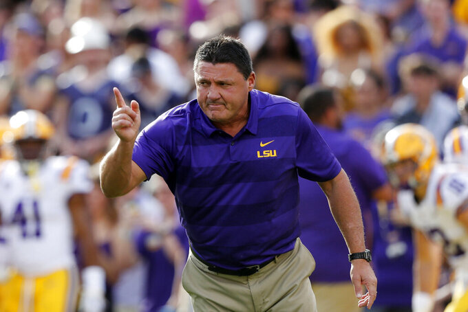 FILE - In this Sept. 8, 2018, file photo, LSU head coach Ed Orgeron leads his team before an NCAA college football game against Southeastern Louisiana, in Baton Rouge, La. LSU travels to defending Sugar Bowl champion Texas to go along with a brutal SEC schedule that features a trip to Alabama and home games with Florida and Texas A&M. (AP Photo/Gerald Herbert, File)