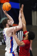 Boise State forward Mladen Armus, left, shoots over SMU forward Isiah Jasey during the second half of an NCAA college basketball game in the first round of the NIT, Thursday, March 18, 2021, in Frisco, Texas. (AP Photo/Tony Gutierrez)