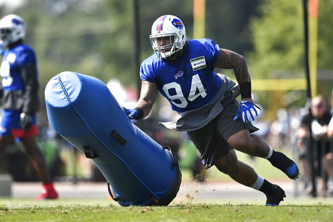 Buffalo Bills defensive tackle Kyle Peko runs a drill during practice at the NFL football team's training camp in Pittsford, N.Y., Friday, July 26, 2019. (AP Photo/Adrian Kraus)