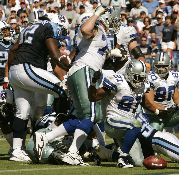 FILE - In this Oct. 1, 2006, file photo, Tennessee Titans defensive tackle Albert Haynesworth, left. stomps the face of Dallas Cowboys center Andre Gurode during the third quarter of their an NFL football game in Nashville, Tenn. Violence is part of the game in many sports. But when the Cleveland's Myles Garrett ripped the helmet off Mason Rudolph and hit the Pittsburgh Steelers' quarterback in the head with it, the Browns' defender crossed a line _ one that attracts the attention of authorities sometimes from within their sport and in other cases from criminal prosecutors. (AP Photo/John Russell, File)