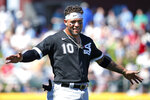 Chicago White Sox third baseman Yoan Moncada (10) gestures after the second inning of a spring training baseball game against the Chicago Cubs, Friday, March 6, 2020, in Mesa, Ariz. (AP Photo/Sue Ogrocki)
