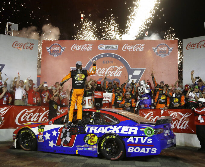 Martin Truex Jr. celebrates in Victory Lane after winning the NASCAR Cup Series auto race at Charlotte Motor Speedway in Concord, N.C., Sunday, May 26, 2019. (AP Photo/Chuck Burton)