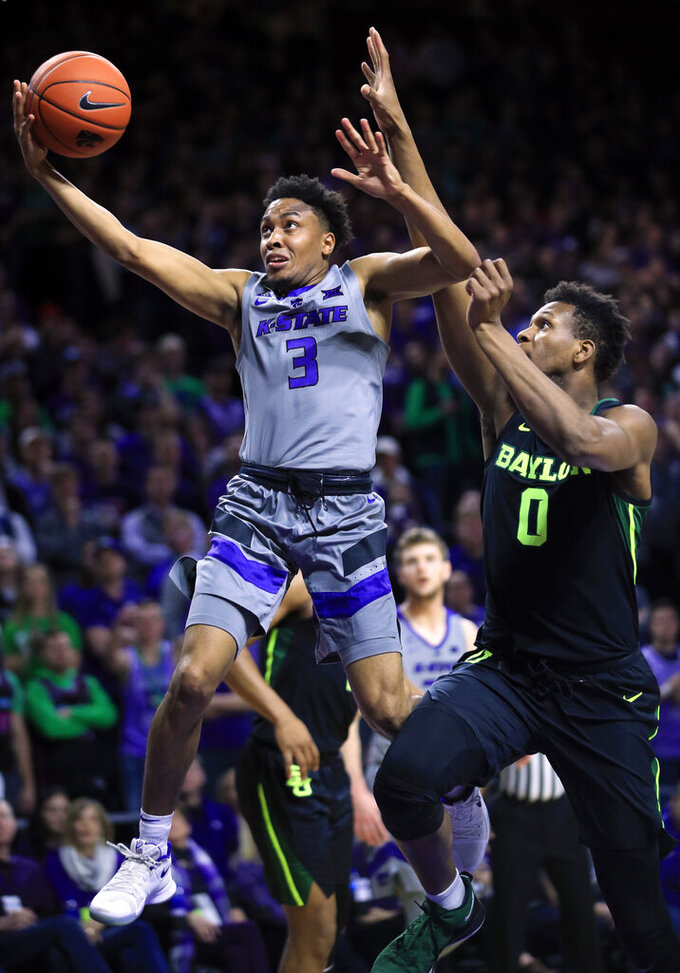 Kansas State guard Kamau Stokes (3) gets past Baylor forward Flo Thamba (0) during the second half of an NCAA college basketball game in Manhattan, Kan., Saturday, March 2, 2019. (AP Photo/Orlin Wagner)