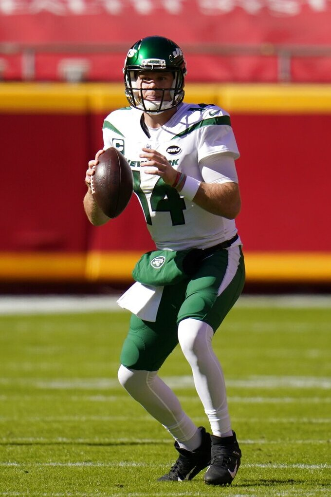 New York Jets quarterback Sam Darnold (14) prepares to throw a pass in the first half of an NFL football game against the Kansas City Chiefs on Sunday, Nov. 1, 2020, in Kansas City, Mo. (AP Photo/Jeff Roberson)