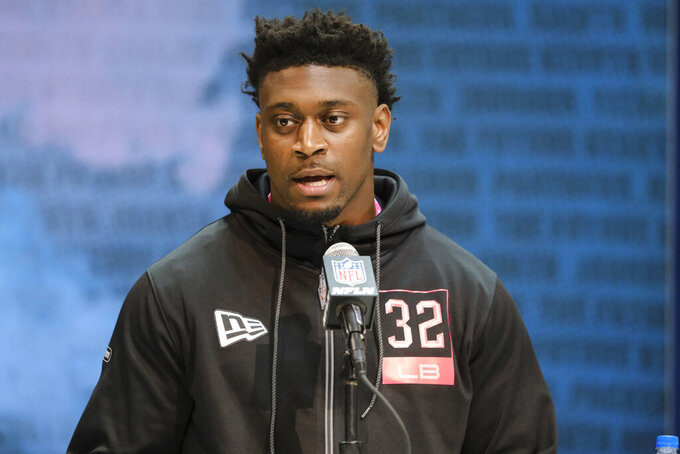 LSU linebacker Patrick Queen speaks during a press conference at the NFL football scouting combine in Indianapolis, Thursday, Feb. 27, 2020. (AP Photo/AJ Mast)