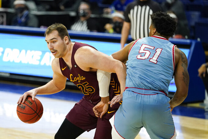Loyola of Chicago center Cameron Krutwig drives to the basket around Drake forward Darnell Brodie, right, during the first half of an NCAA college basketball game, Saturday, Feb. 13, 2021, in Des Moines, Iowa. (AP Photo/Charlie Neibergall)
