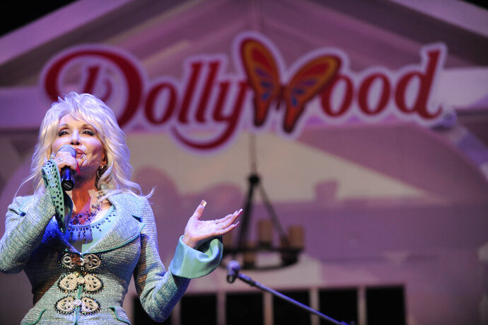 FILE - In this Aug. 21, 2013 file photo, Dolly Parton speaks during a news conference in Pigeon Forge, Tenn.  Dolly Parton's Dollywood has welcomed a fluffy addition to the amusement park — an eaglet. Media outlets report the eaglet hatched Wednesday, April 17, 2019. A social media post by the park says