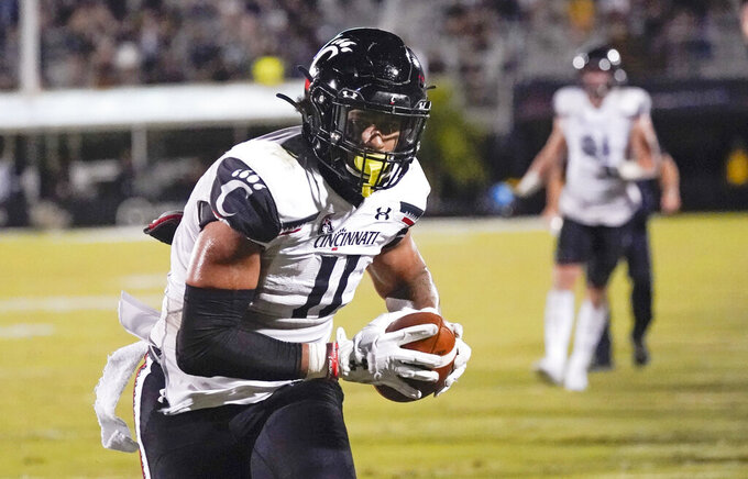 Cincinnati tight end Leonard Taylor (11) runs to the end zone for a 7-yard touchdown off a pass play against Central Florida during the second half of an NCAA college football game, Saturday, Nov. 21, 2020, in Orlando, Fla. (AP Photo/John Raoux)