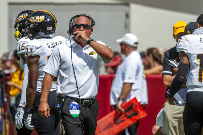 Southern Miss head coach Jay Hopson signals to his booth coaches against Alabama during the first half of an NCAA college football game, Saturday, Sept. 21, 2019, in Tuscaloosa, Ala. (AP Photo/Vasha Hunt)