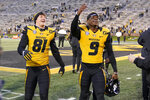 Missouri's Jalen Knox (9) and teammate Shawn Hendershot (81) celebrate following an NCAA college football game against Kentucky Saturday, Oct. 24, 2020, in Columbia, Mo. Missouri won the game 20-10. (AP Photo/L.G. Patterson)