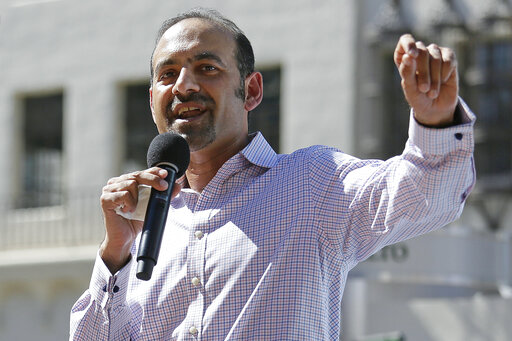 FILE - In this March 14, 2017, file photo Dilawar Syed, president of the software company Freshdesk, speaks during a Tech Stands Up rally outside City Hall in Palo Alto, Calif. If Syed is confirmed as deputy administrator of the Small Business Administration, he will be the highest-ranking Muslim in U.S. government. But his nomination is in peril as Senate Republicans block a committee vote, citing the agency's payouts to abortion providers — the latest in a series of objections to the Pakistani-born businessman's confirmation .(AP Photo/Eric Risberg, File)