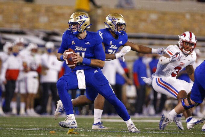 Tulsa quarterback Zach Smith (11) rolls out to pass against SMU during the second half of an NCAA college football game in Tulsa, Okla., Saturday, Nov. 14, 2020. (AP Photo/Joey Johnson)