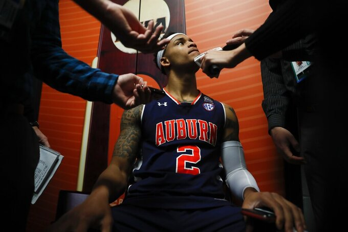 Auburn's Bryce Brown answers questions after a practice session for the semifinals of the Final Four NCAA college basketball tournament, Thursday, April 4, 2019, in Minneapolis. (AP Photo/Jeff Roberson)