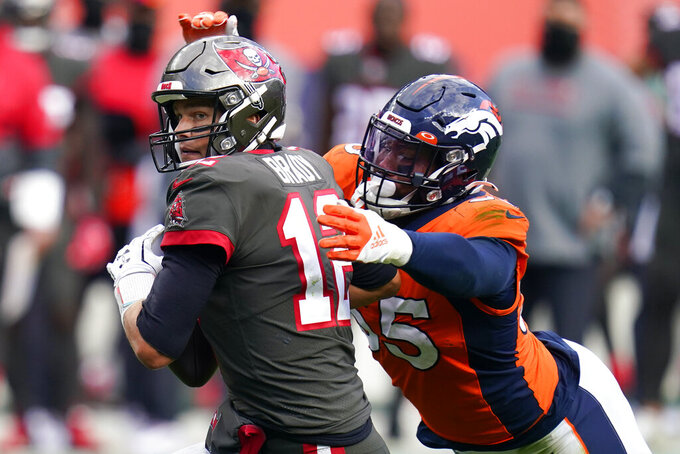Tampa Bay Buccaneers quarterback Tom Brady, left, is sacked by Denver Broncos outside linebacker Bradley Chubb during the second half of an NFL football game Sunday, Sept. 27, 2020, in Denver. (AP Photo/Jack Dempsey)