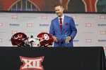 Oklahoma head football coach Lincoln Riley smiles as he heads to sit during NCAA college football Big 12 media days Wednesday, July 14, 2021, in Arlington, Texas. (AP Photo/LM Otero)