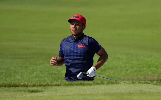 CORRECTS LAST NAME TO SCHAUFFELE FROM SHAUFFELE -  Xander Schauffele of the United States watches his shot from the 17th hole during the final round of the men's golf event at the 2020 Summer Olympics on Sunday, Aug. 1, 2021, in Kawagoe, Japan. (AP Photo/Andy Wong)