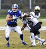 Duke's Noah Gray (87) carries the ball ahead of Wake Forest's Chuck Wade Jr. (9) during the first half of an NCAA college football game in Durham, N.C., Saturday, Nov. 24, 2018. (AP Photo/Ben McKeown)