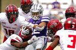 Kansas State running back Deuce Vaughn (22) is tackled by a group of Arkansas State players during the second half of an NCAA college football game Saturday, Sept. 12, 2020, in Manhattan, Kan. (AP Photo/Charlie Riedel)