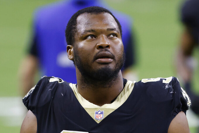 FILE - New Orleans Saints defensive tackle David Onyemata is shown after an NFL football game against the Atlanta Falcons in New Orleans, in this Sunday, Nov. 22, 2020, file photo. Saints starting defensive tackle David Onyemata has been been notified by the NFL he has tested positive for a banned substance and likely is facing a suspension, the player said in a social media post Friday morning, July 16, 2021. (AP Photo/Tyler Kaufman, File)