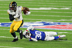 Pittsburgh Steelers running back Benny Snell (24) avoids a tackle by New York Giants cornerback Darnay Holmes (30) during the first quarter of an NFL football game Monday, Sept. 14, 2020, in East Rutherford, N.J. (AP Photo/Seth Wenig)