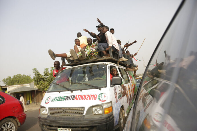 Supporters of Nigerian presidential candidate Atiku Abubakar, of the People's Democratic Party attend an election campaign rally at the Ribadu Square in Yola, Nigeria, Thursday, Feb. 14, 2019. Nigeria goes to the polls on Saturday to elect a new president. (AP Photo/Sunday Alamba)