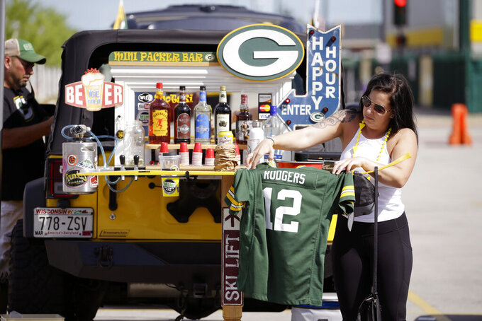 Fans tailgate in the parking lot of Lambeau Field prior to the start of a preseason NFL football game between the Green Bay Packers and Houston Texans Thursday, Aug. 8, 2019, in Green Bay, Wis. (AP Photo/Jeffrey Phelps)