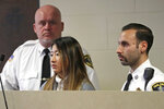 "Inyoung You, 21, appears in Suffolk Superior Court, Friday, Nov. 22, 2019, in Boston. The former Boston College student pleaded not guilty to involuntary manslaughter in a case accusing her of encouraging her boyfriend Alexander Urtula to take his life. Prosecutors say she sent Urtula more than 47,000 text messages in the last two months of the relationship, including many urging him to ""go kill yourself."" (David L Ryan/The Boston Globe via AP, Pool)"