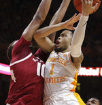 Tennessee guard Lamonte Turner (1) attempts a shot over Arkansas forward Daniel Gafford (10) in the first half of an NCAA college basketball game, Tuesday, Jan. 15, 2019, in Knoxville, Tenn. (AP Photo/Shawn Millsaps)
