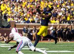 Michigan tight end Zach Gentry (83) catches a 32-yard pass for a first down, defended by SMU cornerback Eric Sutton (1), in the first quarter of an NCAA college football game in Ann Arbor, Mich., Saturday, Sept. 15, 2018. (AP Photo/Tony Ding)