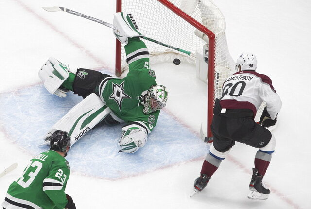 Dallas Stars goalie Anton Khudobin (35) is scored on by Colorado Avalanche's Vladislav Namestnikov (90) during second period NHL qualifying round game action in Edmonton, on Wednesday, Aug. 5, 2020. (Jason Franson/The Canadian Press via AP)