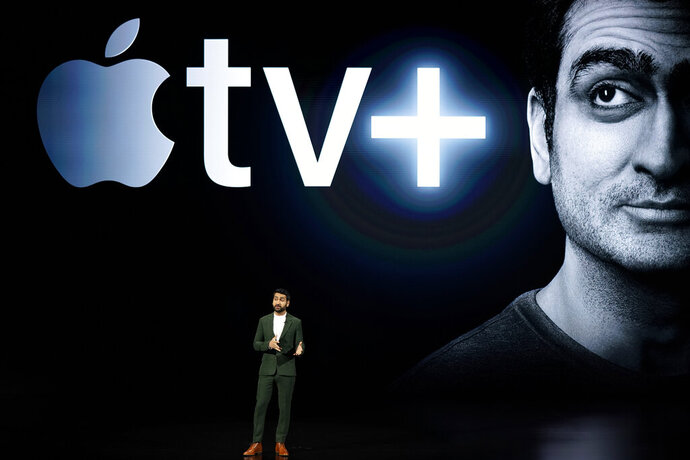 Kumail Nanjiani speaks at the Steve Jobs Theater during an event to announce new Apple products Monday, March 25, 2019, in Cupertino, Calif. (AP Photo/Tony Avelar)