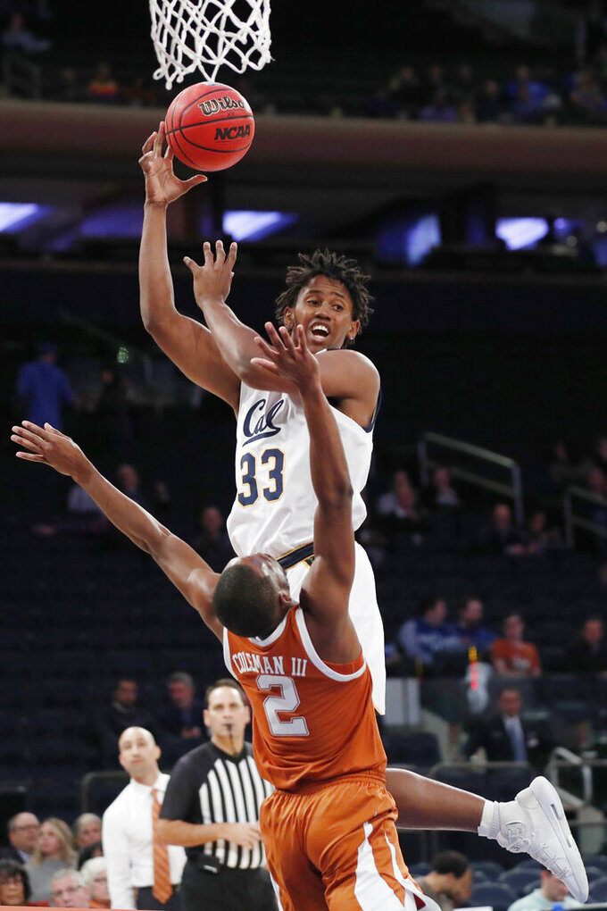 California forward D.J. Thorpe (33) passes as he collides with Texas guard Matt Coleman III (2) beneath the basket during the first half of an NCAA college basketball game in the 2K Empire Classic, Friday, Nov. 22, 2019, in New York. (AP Photo/Kathy Willens)