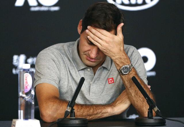 Switzerland's Roger Federer reacts during press conference following his semifinal loss to Serbia's Novak Djokovic at the Australian Open tennis championship in Melbourne, Australia, Thursday, Jan. 30, 2020. (AP Photo/Dita Alangkara)