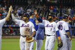 New York Mets' Dominic Smith (22) and Amed Rosario (1) celebrate with teammates after a baseball game against the Philadelphia Phillies on Saturday, July 6, 2019, in New York. The Mets won 6-5. (AP Photo/Frank Franklin II)