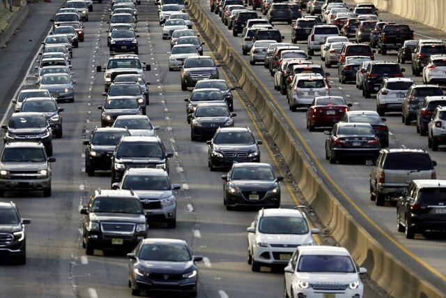 FILE - In this April 10, 2019, file photo, rush-hour traffic heads east, left, and west, right, along the Schuylkill Expressway in Philadelphia. A spokesman for Pennsylvania's governor said the state was committed to being a part of Transportation and Climate Initiative conversations. But a growing number of Northeast governors have concerns the TCI could increase gas prices, and raise doubts about how effective it would be in capping pollution. The initiative is aimed at a dozen Northeast and mid-Atlantic states and would take effect in 2022. (AP Photo/Jacqueline Larma, File)