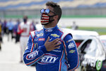 Bubba Wallace stands for the National Anthem before the start of a NASCAR Cup Series auto race Sunday, July 12, 2020, in Sparta, Ky. (AP Photo/Mark Humphrey)