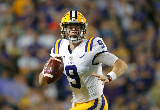 FILE - In this Nov. 30, 2019, file photo, LSU quarterback Joe Burrow (9) scrambles during the first half of an NCAA college football game against Texas A&M, in Baton Rouge, La. LSU quarterback Joe Burrow is The Associated Press college football player of the year in a landslide vote.  Burrow, who has led the top-ranked Tigers to an unbeaten season and their first College Football Playoff appearance, received 50 of 53 first-place votes from AP Top 25 poll voters and a total of 156 points.  (AP Photo/Gerald Herbert, File)
