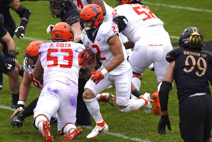 Illinois running back Chase Brown (2) runs with the ball against Northwestern during the first half of an NCAA college basketball game in Evanston, Ill., Saturday, Dec. 12, 2020. (AP Photo/Nam Y. Huh)