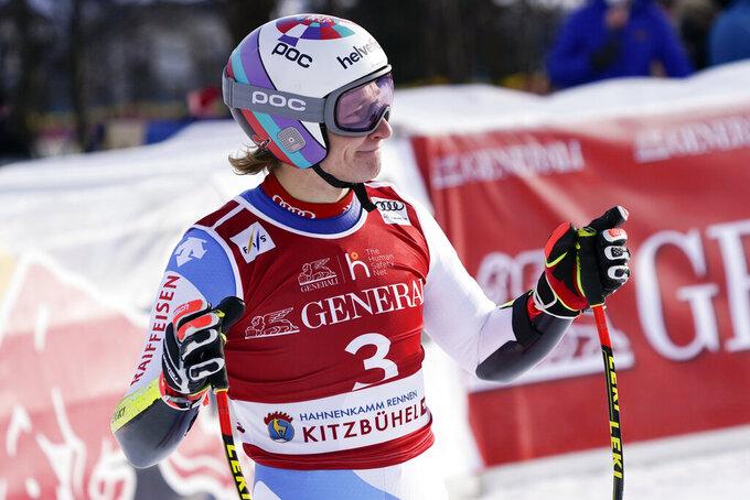 Switzerland's Marco Odermatt checks his time at the finish area of an alpine ski, men's World Cup Super-G, in Kitzbuehel, Austria, Monday, Jan. 25, 2021. (AP Photo/Giovanni Auletta)