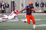 Illinois running back Ra'Von Bonner (21) eludes the tackle of Rutgers linebacker Drew Singleton during the first half of an NCAA college football game Saturday, Nov. 2, 2019, in Champaign, Ill. (AP Photo/Charles Rex Arbogast)