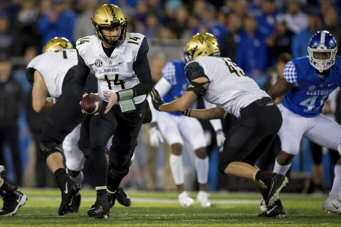 Vanderbilt quarterback Kyle Shurmur (14) hands the ball off to tight end Cody Markel (45) during an NCAA college football game against Kentucky in Lexington, Ky., Saturday, Oct. 20, 2018. (AP Photo/Bryan Woolston)