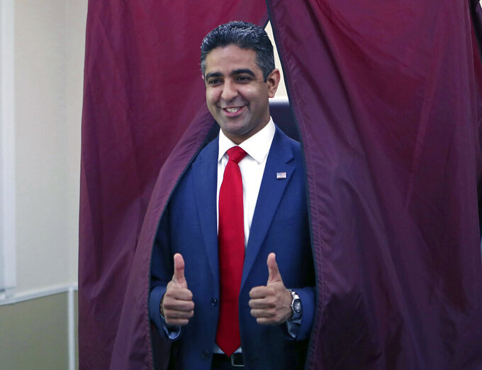 FILE - In this June 5, 2018, file photo, Republican candidate for Congress, Hirsh Singh, of Linwood, N.J., gestures after he voted at the Linwood Library in the state's primary election in Linwood, N.J. New Jersey voters will decide Tuesday, June 8, 2021 who their candidates will be in the fall election for governor and in every seat in the Democrat-led state Legislature.  (Craig Matthews/The Press of Atlantic City via AP, File)