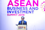 Thailand Prime Minister Prayuth Chan-ocha delivers a speech during the opening of the ASEAN Business and Investment Summit (ABIS) in Nonthaburi, Thailand, Saturday, Nov. 2, 2019. (AP Photo/Wason Wanichakorn)