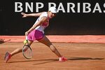 Romania's Simona Halep returns the ball during her match with Ukraine's Dayana Yastremska during their Italian Open tennis tournament match, in Rome, Friday, Sept. 18, 2020. (Alfredo Falcone/LaPresse via AP)