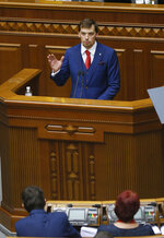 A newly elected Ukraine's prime minister Oleksiy Honcharuk speaks during parliament session in Kyiv, Ukraine, Thursday, Aug. 29, 2019. Parliament in Ukraine has opened for its first session since an election last month. (AP Photo/Efrem Lukatsky)
