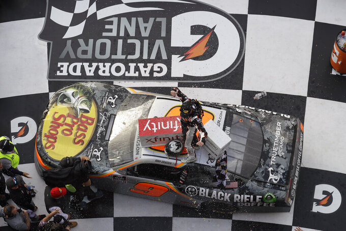Noah Gragson celebrates on roof of his car in Victory Lane after winning the NASCAR Xfinity series auto race Saturday, Feb. 15, 2020, at Daytona International Speedway in Daytona Beach, Fla. (AP Photo/Chris O'Meara)